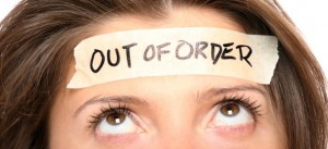 Woman-with-Out-of-Order-Sign-on-Head